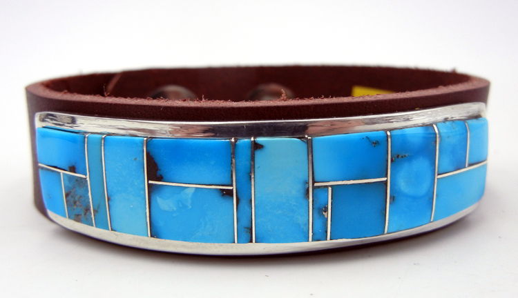 Navajo turquoise and sterling silver channel inlay on brown leather bracelet
